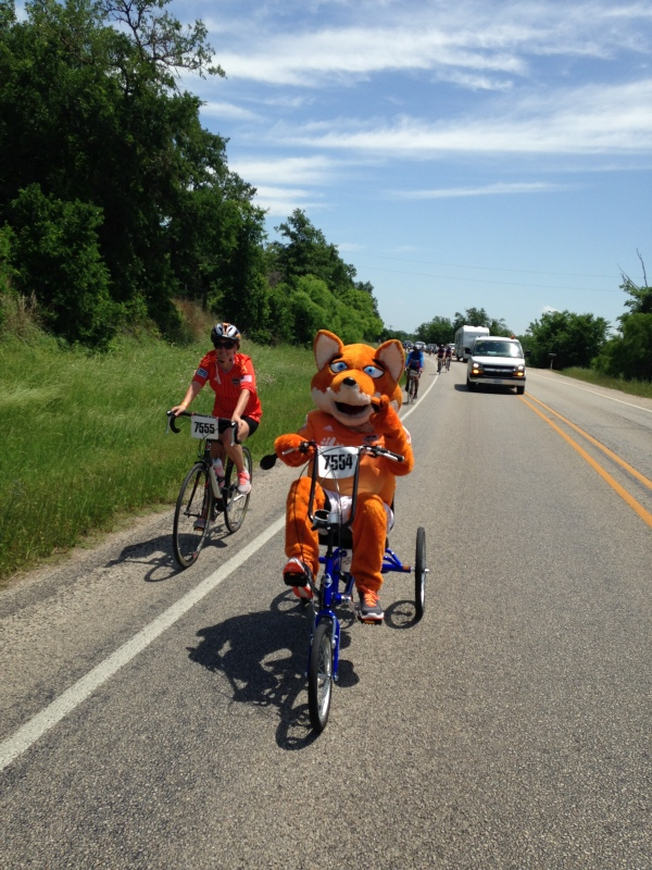 The mascot for the Houston Dynamo made the ride too! In fact the mascots for the Rockets and the Astros rode too. I don't know they do it without dying of heatstroke but, much respect for them!